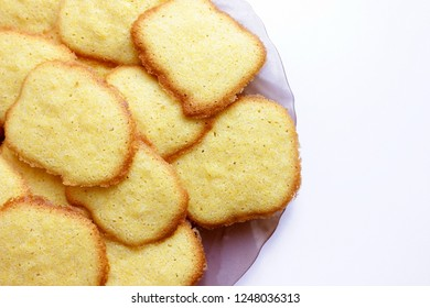 Slide round, yellow, sweet cookies on a plate on white background