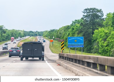 Slidell, USA - April 22, 2018: Highway road with welcome to Louisiana sign and text on street with cars in traffic on interstate i10