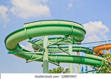 Slider in swimming pool on blue sky background