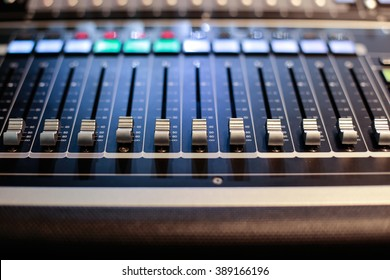 Sliders of the Hi-End stage controller - blurred closeup background