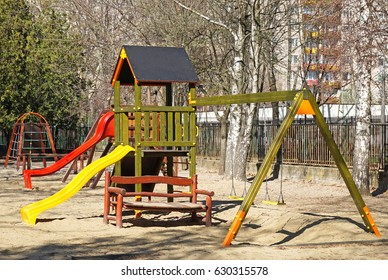 Slides and jungle gym at yard of the kindergarten