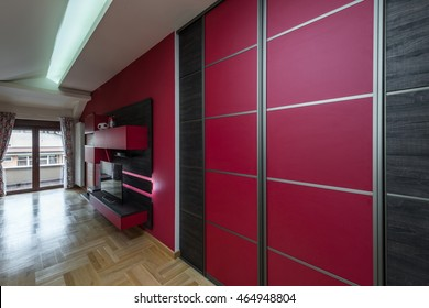 Sliding doors wardrobe in red and brown