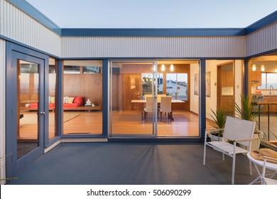 Sliding doors within open Courtyard at twilight.