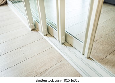 sliding glass door detail and rail embed in wooden floor