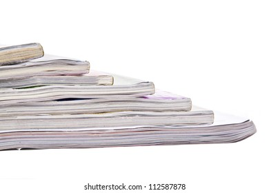 Sliding stack of thick magazines.