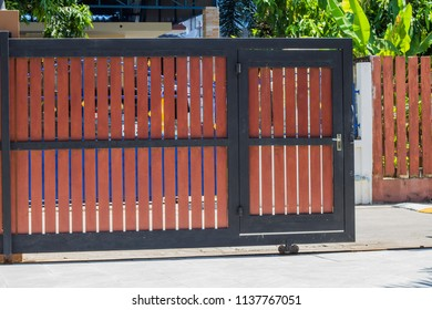 Sliding Wooden Fence Door.