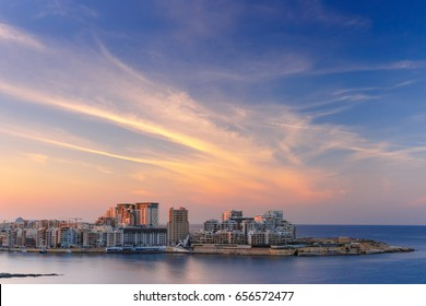 Sliema, major residential and commercial area and a centre for shopping, dining, and cafe life in Malta. Skyline in the Strand and Tigne Point at sunset as seen from Valletta