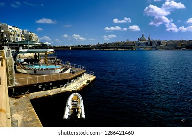 Sliema, Malta - 10th July 2018:Ballisca of Our Lady of Mount Careml above the harbour of Sliema and the old Town of Valletta