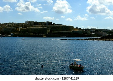 Sliema, Malta - 10th July 2018:Boats in the harbour of Sliema and Fort Saint Elmo