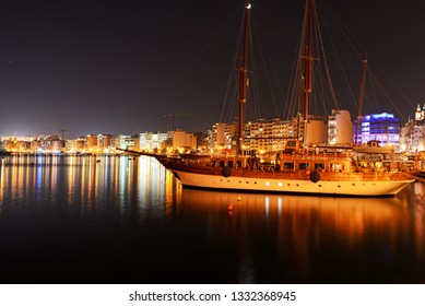 SLIEMA, MALTA - APRIL 21: The Hera cruises yacht and night view on Sliema, on April 21, 2015 in Sliema, Malta. More then 1,6 mln tourists is expected to visit Malta in year 2015.