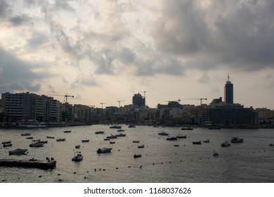 SLIEMA, MALTA - AUGUST 05, 2018: view from Sliema of the sea with many small boats in a cloudy day.