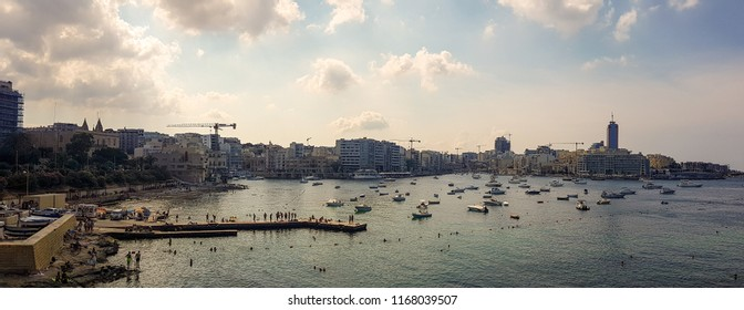 SLIEMA, MALTA - AUGUST 05, 2018: panoramic view from Sliema of the sea with many small boats in a cloudy day.