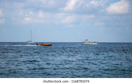 SLIEMA, MALTA - AUGUST 05, 2018: some boats moving in the sea on a summer day.