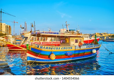 SLIEMA, MALTA - JUNE 19, 2018: The colorful pleasure boats moored at the shore of Resort and offer different trips around Valletta to the tourists and holidaymakers, on June 19 in Sliema