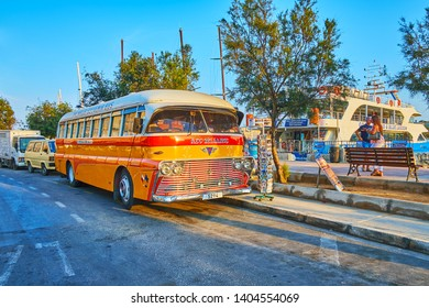 SLIEMA, MALTA - JUNE 19, 2018: The vintage AEC-Reliance bus, parked at the seaside promenade, serves as the souvenir store and attracts the tourists, walking around the harbor, on June 19 in Sliema