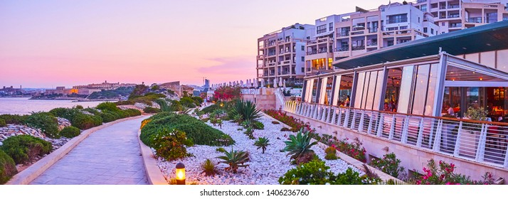 SLIEMA, MALTA - JUNE 19, 2018: Explore Tigne Point with its modern architectural complex, including hotel, restaurants, cafes and shopping mall, surrounded by coastal garden, on June 19 in Sliema