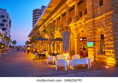 SLIEMA, MALTA - JUNE 19, 2018: The line of outdoor cafes, stretching along the Tigne Point shopping mall, located on the same named peninsula, on June 19 in Sliema