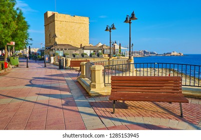 SLIEMA, MALTA - JUNE 20, 2018: The St Julian's Tower is located in seaside promenade and surrounded by cafes and recreational zone, on June 20 in Sliema.