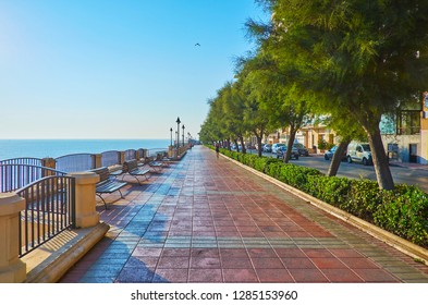 SLIEMA, MALTA - JUNE 20, 2018: The seaside Tower Road is popular among the joggers and tourists, enjoying morning walks, on June 20 in Sliema.