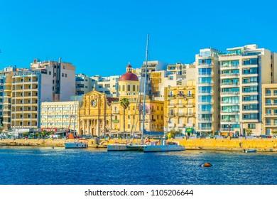 SLIEMA, MALTA, MAY 2, 2017: People are strolling on seaside of Sliema, Malta