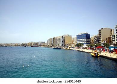 SLIEMA, MALTA. MAY 20, 2013.  The promenade and seafront with pleasure and working boats at moorings of Sliema, Malta.