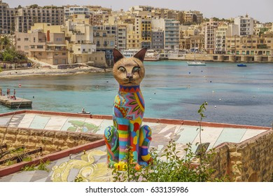 SLIEMA, MALTA - MAY 2016: Colourful big cat sculpture can be seen at at Independence Garden while walking Sliema promenade. Created by Matthew Pandolfino and placed there during Sliema Art Festival.