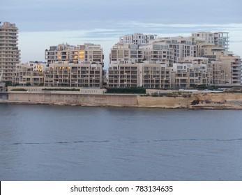 Sliema, Malta / Malta - November 2017: Waterfront buildings in Sliema seen from Valletta in Malta.
