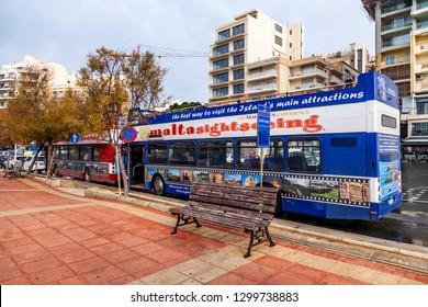Sliema, Malta, on January 5, 2019. Krasivaya Embankment. Tourist buses wait for passengers at a stop
