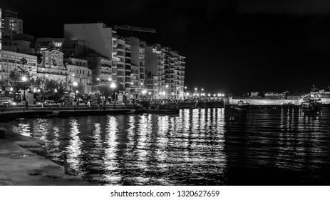 Sliema, Malta, on January 5, 2019. Night look. the picturesque embankment of the bay lit with evening fires which are reflected in bay water