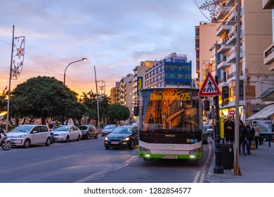 Sliema, Malta, on January 8, 2019. The bus goes on the beautiful embankment of the bay in the evening