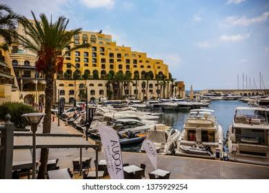 SLIEMA, MALTA - September 2018: Boats and yachts on the water in Sliema Bay, cloudy morning in Sliema, Malta