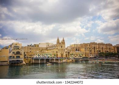 SLIEMA, MALTA - September 2018: Church of the Virgin of Carmen in Sliema, view from the bay, Malta