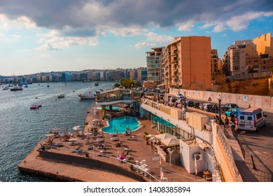 SLIEMA, MALTA - September 2018: Sliema cityscape with swimming pool and Sliema Bay view, cloudy morning in Sliema, Malta