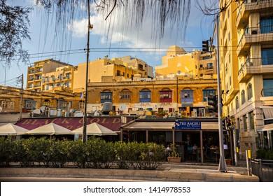 Sliema, Malta - September 2018: Sliema cityscape, Traditional Maltese architecture, narrow street and old houses, Sliema, Malta