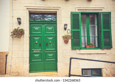 SLIEMA, MALTA - September 2018: Colorful wooden doors and window frames of the old house in Sliema, Malta