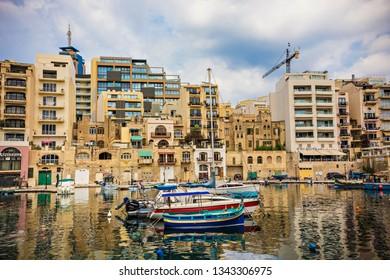 SLIEMA, MALTA - September 2018: Colorful boats on water in Sliema Bay, Mlta