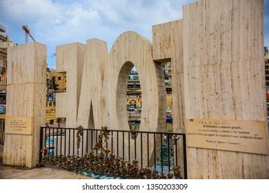 Sliema, Malta - September 2018: Love monument at Sliema bay, Malta