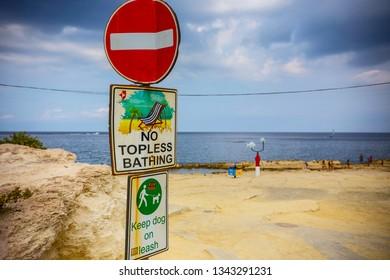 SLIEMA, MALTA - September 2018: No topless bathing warning sign on the beach at Sliema, Malta
