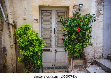 Sliema, Malta - September 2018: Old house doors with hibiscus bushes nearby, Sliema, Malta
