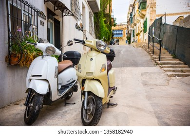 Sliema, Malta - September 2018: Two motorbikes on the narrow street of Sliema, Malta