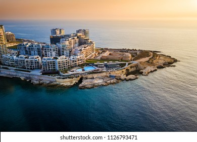 Sliema, Malta - Sunrise at Tigne point with residential buildings
