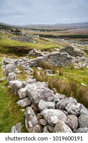 Slievemore is a ruined famine village, on Achill Island, County Mayo, Ireland. A potato blight over four years in the mid 19th century halved Ireland's population, through death or emigration