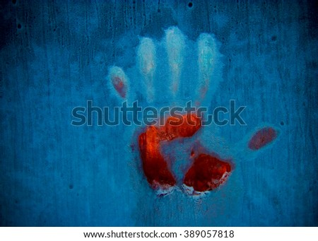 Slightly blurred bloody handprint on a frozen window (symbolizing horror or fear, with copy space for your text)