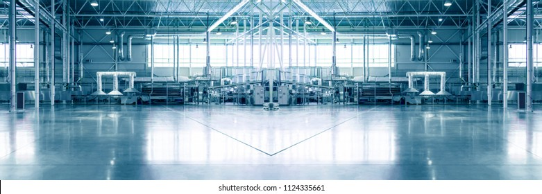 Slightly blurred and defocused background for your design. Piece of empty typical industrial space. Concept of manufacture, warehouse, storage, factory space. Copy space. Wide panoramic image.