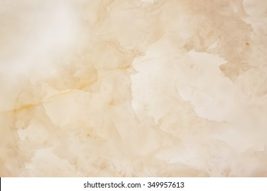 Slightly  blurred lightened slices marble. Horizontal image. Warm colors. Beautiful close up background. Ideal for sites, banners, brochures, design