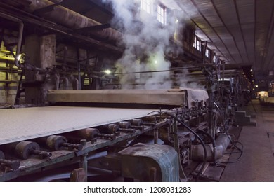 Slightly blurred vintage machine for pulp production during process in pulp and paper plant.