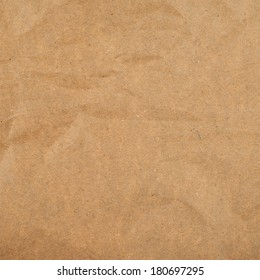 Slightly creased cheap brown packaging paper texture background