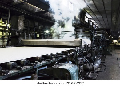 Slightly over exposed and de-focused retro machine for pulp production during process in pulp and paper plant.