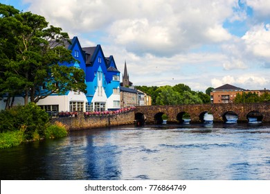 Sligo, Ireland. Beautiful landscape in Sligo, Ireland with river and colorful houses. Cloudy sky in summer, old bridge over the river