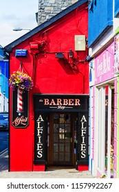 SLIGO, IRELAND - JULY 12, 2018: Colorful exterior of a barber shop in Sligo city, Ireland.